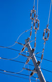 Junction of power lines and insulators on pole. Royalty Free Stock Image