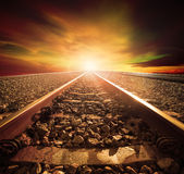 Junction of railways track in trains station agains beautiful li Stock Image