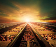 Junction of railways track in trains station agains beautiful li Royalty Free Stock Photos