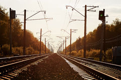 Junction of railways track in trains station against  beautiful light sun set sky use for land transport. Junction of railways track in trains station against Royalty Free Stock Image