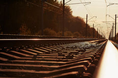 Junction of railways track in trains station against  beautiful light sun set sky use for land transport. Junction of railways track in trains station against Royalty Free Stock Photos