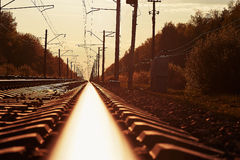 Junction of railways track in trains station against  beautiful light sun set sky use for land transport Stock Images