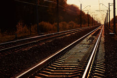 Junction of railways track in trains station against beautiful light sun set sky use for land transport royalty free stock images