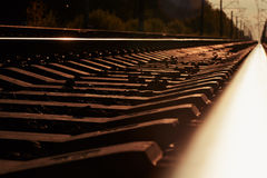 Junction of railways track in trains station against  beautiful light sun set sky use for land transport Royalty Free Stock Photo