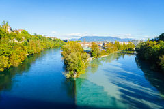 Junction of the Rhone and Arve. Two rivers junction ,the Rhone and the Arve, in autumn, in Geneva, Switzerland Stock Image