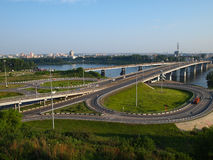 Junction of roads with two rings and a bridge. Bridge with roads and transportation over the river the Tom, Kemerovo, Russia Stock Photography