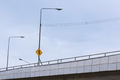 Junction sign and light poles on the bridge. Road junction sign and light poles on the bridge Royalty Free Stock Photography