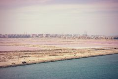 The junction of the Suez Canal into the Mediterranean at Port Sa Stock Images