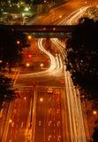 Junction traffic flow at night. Night light traffic flow at a junction, a stop at the cross road Royalty Free Stock Image