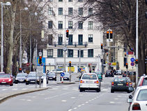 Junction with waiting cars and red traffic lights Stock Photography