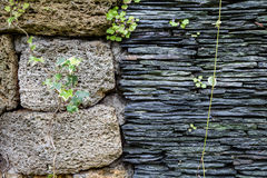 Junction of walls with two different textures. Layers of uneven stock photos