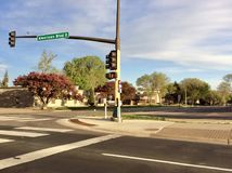 American street. At a junction with Zebra crossings Royalty Free Stock Photo