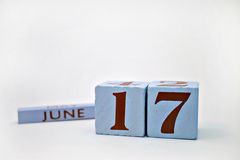June 17c. Wooden blocks with the date June 17, as a reminder of Father's Day Stock Photography