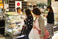 June 2018, Japanese Women Buy Sell Healthy Fresh Take Away Foods, Nishiki Market Kyoto, Japan Stock Images