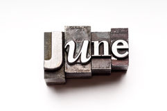 June. The month of June done in letterpress type on a white paper background
