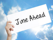 June Ahead Sign on white paper. Man Hand Holding Paper with text Royalty Free Stock Photo