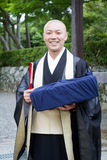 June 2012 - Arashiyama, Japan: A monk at the Tenryuji Temple temple looking at the camera and smile Royalty Free Stock Photography