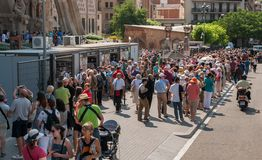 Tourists queue to buy tickets to visit The Sagrada Familia Cathedral in Barcelona stock image