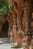 Young girl walking at Park Guell. Barcelona royalty free stock image