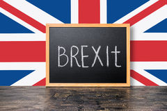 June 23: Brexit UK EU referendum concept with flag and handwriting text written in chalkboard on black. Craquelure background, close up royalty free stock photo