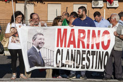 11 June 2015. Citizens protest against the gypsies and Mayor. Rome, Italy. 11 June 2015. Rome, Italy. In the banner - Marino (Mayor of Rome) clandestine Royalty Free Stock Photography