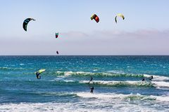 June 6, 2019 Davenport / CA / USA - People kite surfing in the Pacific Ocean, near Santa Cruz, on a sunny and warm day stock images