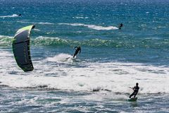 June 6, 2019 Davenport / CA / USA - People kite surfing in the Pacific Ocean, near Santa Cruz, on a sunny and warm day royalty free stock photography