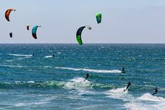 June 6, 2019 Davenport / CA / USA - People kite surfing in the Pacific Ocean, near Santa Cruz, on a sunny and warm day royalty free stock image
