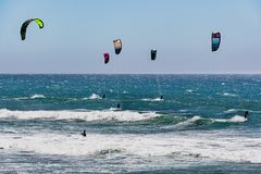 June 6, 2019 Davenport / CA / USA - People kite surfing in the Pacific Ocean, near Santa Cruz, on a sunny and warm day stock photos