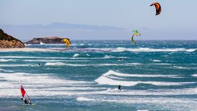 June 6, 2019 Davenport / CA / USA - People kite and wind surfing in the Pacific Ocean, near Santa Cruz, on a sunny and warm day stock image