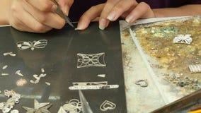 June 6 2016 filigree jewelers  work with silver in Ta' Qali Crafts Village in Malta stock video footage