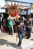 Flute seller blowing  flute on his work place. June 30, 2015. a flute seller boy on his working place to sell flutes and also he is blowing the air instrument to Stock Images