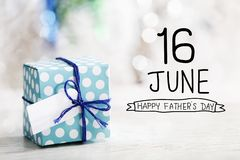16 June Happy Fathers Day  message with gift box stock photos