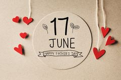17 June Happy Fathers Day message with small hearts. 17 June Happy Fathers Day message with handmade small paper hearts royalty free stock photo