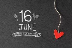 16 June Happy Fathers Day message with paper hearts stock image