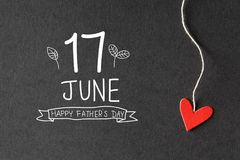 17 June Happy Fathers Day message with paper hearts stock photography