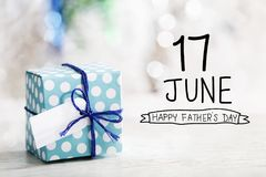 17 June Happy Fathers Day message with gift box. 17 June Happy Fathers Day message with small handmade gift box royalty free stock photography