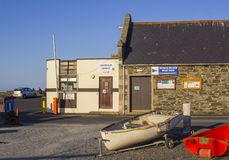 The local harbour office in groomsport Village in County Down Ireland shut up for the evening stock images