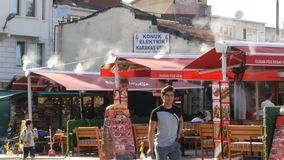 June 11, 2019 - Istanbul, Turkey: A street restaurant of Turkish cuisine on roof of which fumes steam stock footage