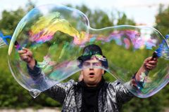 June 2, 2018. Izhevsk, Russia. A man magician in a hat lets large bubbles. stock images