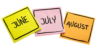 June, July and August on sticky notes Stock Photography