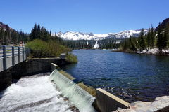 June lake. In California with snowy mountains and sunny sky Royalty Free Stock Photography