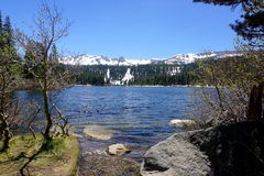 June lake. In California with snowy mountains and sunny sky Stock Photo