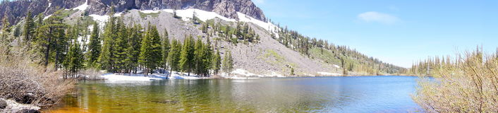 June lake. In California with snowy mountains and sunny sky Stock Images