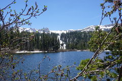 June lake. In California with snowy mountains and sunny sky Royalty Free Stock Photo