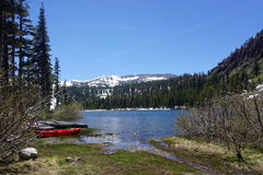 June lake. In California with snowy mountains and sunny sky Royalty Free Stock Images