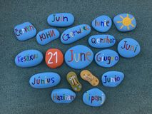 21 June in many languages on stones Stock Photos