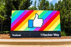 The Facebook Like Button on a rainbow flag background royalty free stock photo