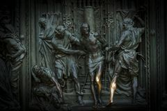 The door of the central entrance of the Duomo Cathedral of Milan with elements of the life of Jesus. Royalty Free Stock Photos