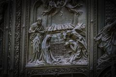 The door of the central entrance of the Duomo Cathedral of Milan with elements of the life of Jesus. Royalty Free Stock Images